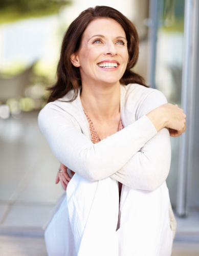 Woman smiling after getting dental implants at Frank W. Sallustio, DDS in Sun City West, AZ